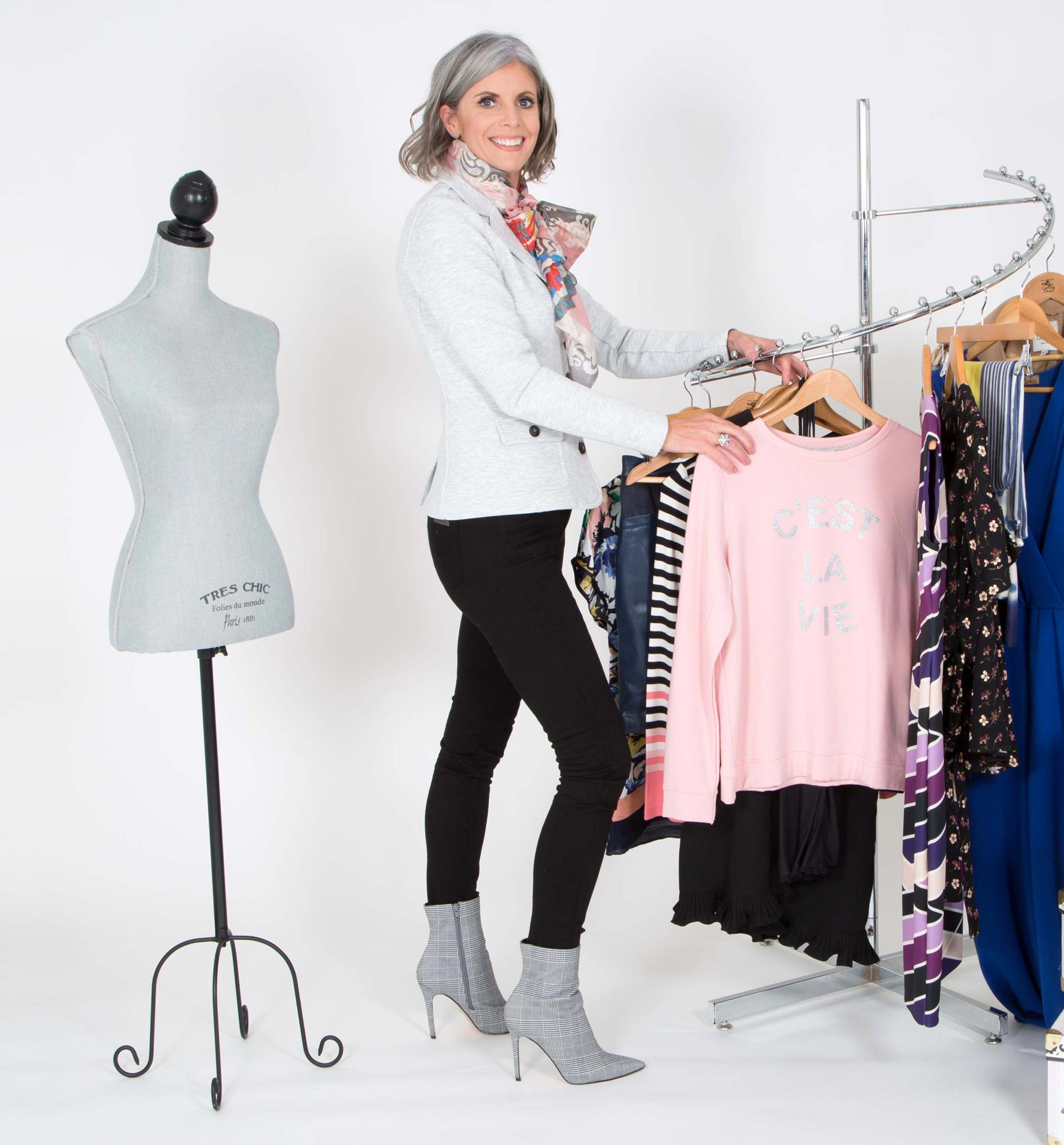 Bernie Delaney - looking at dresses on a cloths rack