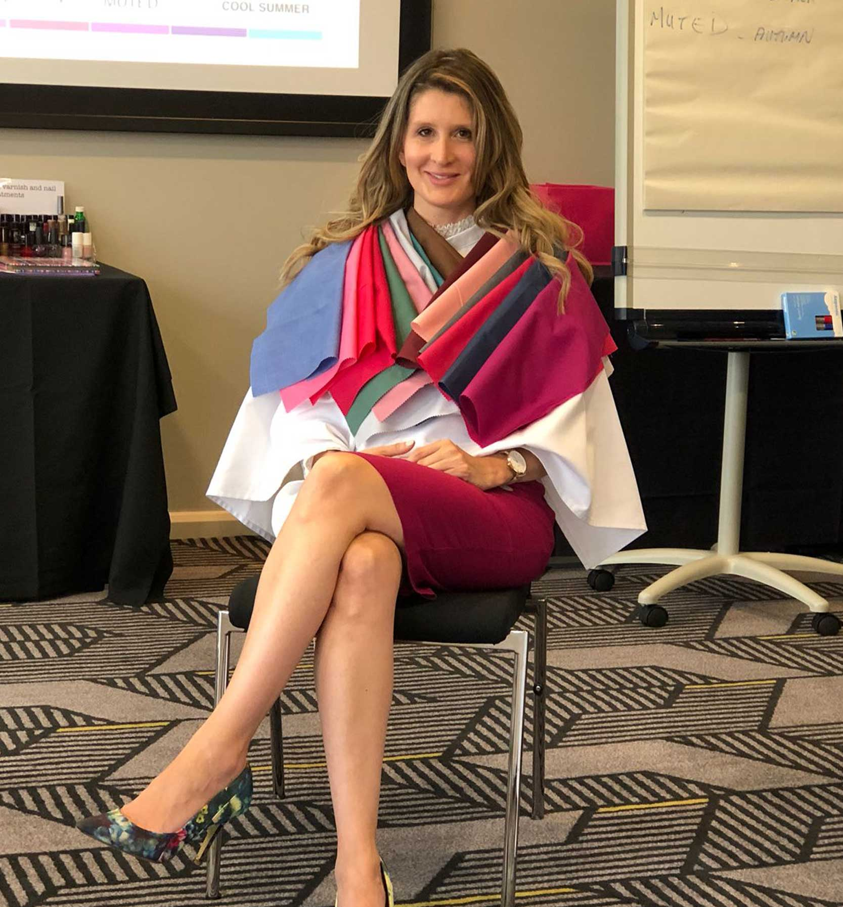 Photo of Monica Fuentes Style Coaching - sitting dow with cloths swatches on her shoulders